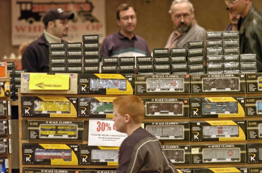 Times Union staff photo by Paul Buckowski ---    , (cq) ,  Visitors look over the model train items for sale  At the annual Great Train Extravaganza at the Empire State Plaza Convention Center in Albany, N.Y. on Sunday, Dec. 3, 2006.  The event is put on by the Upstate Train Association and it is always held on the first Sunday in December.  A train layout by the association that was at the extravaganza will be dismantled on taken to the Schenectady Museum & Suit-Bueche Planetarium where it will be put up and on display through January 15, 2007. (Hearst)