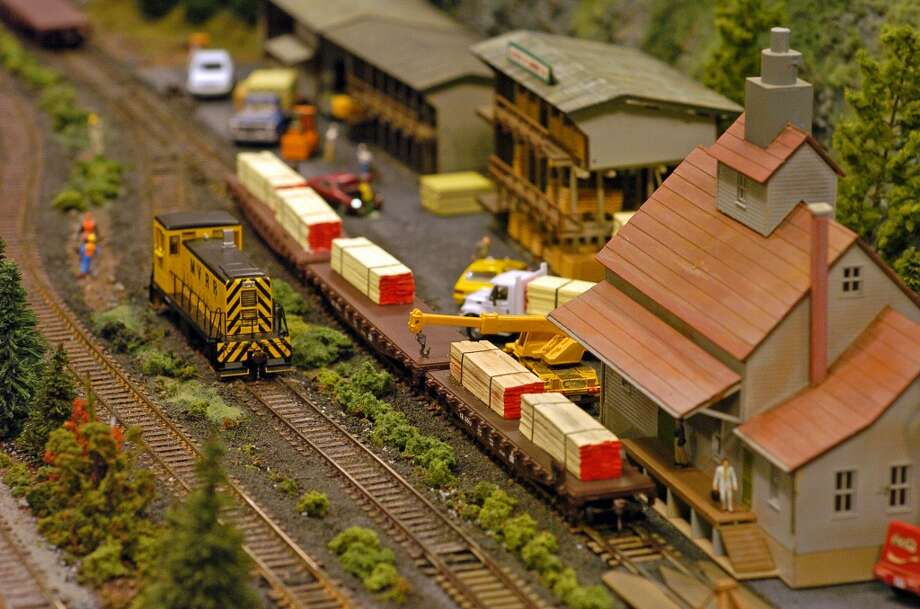 Times Union staff photo by Paul Buckowski ---    , (cq) ,  A view of one of the train layouts on display  at the annual Great Train Extravaganza at the Empire State Plaza Convention Center in Albany, N.Y. on Sunday, Dec. 3, 2006.  The event is put on by the Upstate Train Association and it is always held on the first Sunday in December.  A train layout by the association that was at the extravaganza will be dismantled on taken to the Schenectady Museum & Suit-Bueche Planetarium where it will be put up and on display through January 15, 2007. (Hearst)