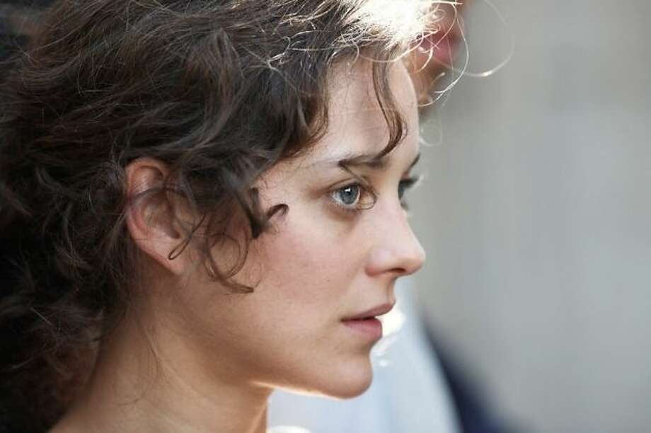 Marion Cotillard -- you like her already.  Just wait until you see her in RUST AND BONE.