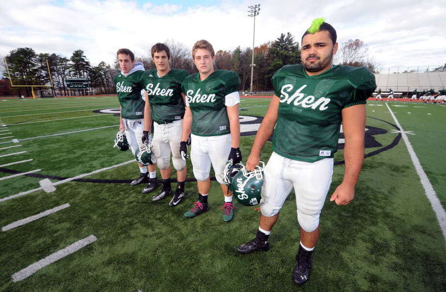 Shenendehowa High School football defensive lineman Eric Hurd, left, Eric Kromer, Chris Stewart and Alan Gaines Oct. 31in Clifton Park. (Michael P. Farrell/Times Union)