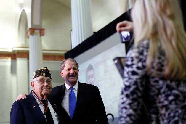 World War II Veteran Virgil Poe poses for a photo with his son, Congressman Ted Poe, during the Saddle Up Texas Straw Poll at Union Station at Minute Maid Park on Jan. 13, 2012, in Houston. Photo: Michael Paulsen, Houston Chronicle / © 2011 Houston Chronicle