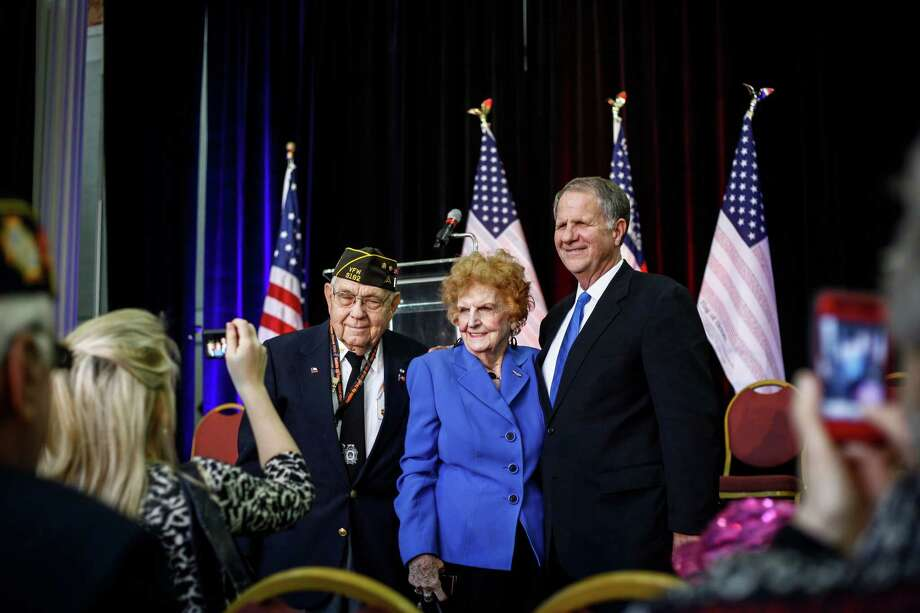 World War II Veteran Virgil Poe poses for a photo with his wife, Dorrace, and son, Congressman Ted Poe, during the Saddle Up Texas Straw Poll at Union Station at Minute Maid Park on Jan. 13, 2012, in Houston. Photo: Michael Paulsen, Houston Chronicle / © 2011 Houston Chronicle