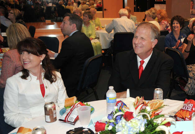 Congressman Ted Poe and Mary Nolan enjoy a performance at the Heroes Lunch at the Kingwood Chamber of Commerce meeting at The Nathaniel Center on June 2, 2010. Photo: Jerry Baker, For The Chronicle / Freelance