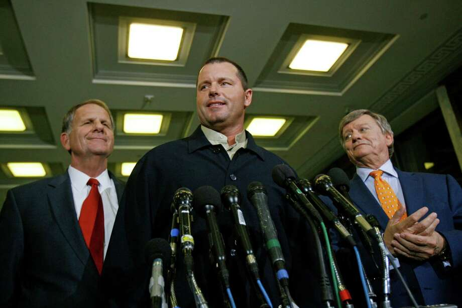 Former Houston Astros pitcher Roger Clemens is flanked by his attorney and Ted Poe on Feb. 7, 2008, in Washington, D.C. Photo: Jose Luis Magana, AP / AP