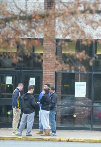 Grieving students gather Sunday outside Shenendehowa High School East in Clifton Park.  (Paul Buckowski / Times Union) Photo: Paul Buckowski
