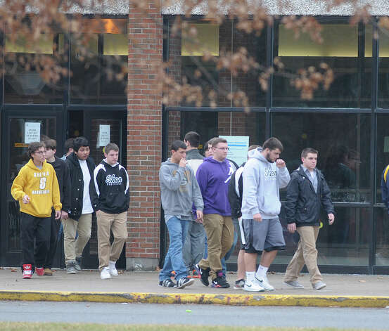 Students on Sunday leave Shenendehowa High School East in Clifton Park.  The school had grief counselors on hand for students dealing with the death of two of their classmates in a Saturday car accident on the Northway.  (Paul Buckowski / Times Union) Photo: Paul Buckowski