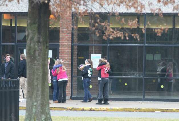 Students embrace each other Sunday outside the Shenendehowa High School East building in Clifton Park.  The school had grief counselors on hand for students dealing with the death of two of their classmates in a car accident Saturday on the Northway.  (Paul Buckowski / Times Union) Photo: Paul Buckowski