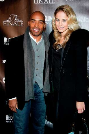Some people —ahem, Tiki Barber and Traci Lynn Johnson — didn't get the memo that this was a costume party. Here. they attend Heidi Klum's Haunted Holiday Party benefiting Superstorm Sandy relief efforts, on Saturday, Dec. 1, 2012 in New York. Photo: Charles Sykes, Charles Sykes/Invision/AP / Invision2012