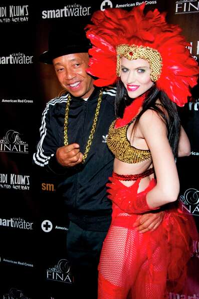 Hana Nitsche and Russell Simmons attend Heidi Klum's Haunted Holiday Party benefiting Superstorm San
