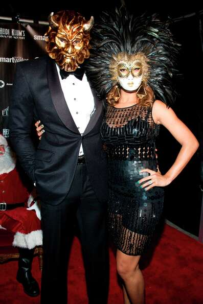 Amare Stoudemire and Alexis Welch attend Heidi Klum's Haunted Holiday Party benefiting Superstorm Sa