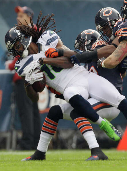 Seattle Seahawks wide receiver Sidney Rice (18) is tackled by Chicago Bears cornerback Charles Tillm