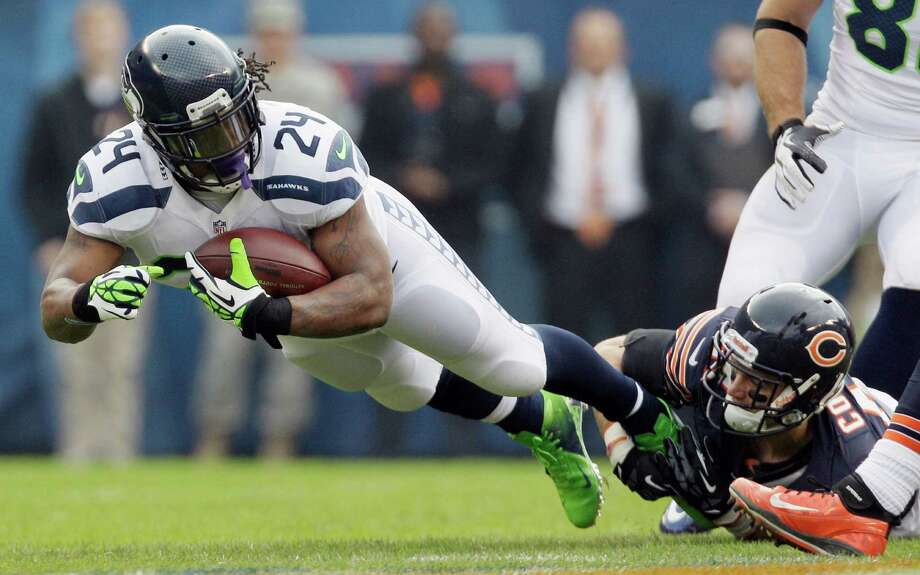Seattle Seahawks running back Marshawn Lynch (24) is tackled by Chicago Bears free safety Chris Conte in the first half of an NFL football game in Chicago, Sunday, Dec. 2, 2012. Photo: AP