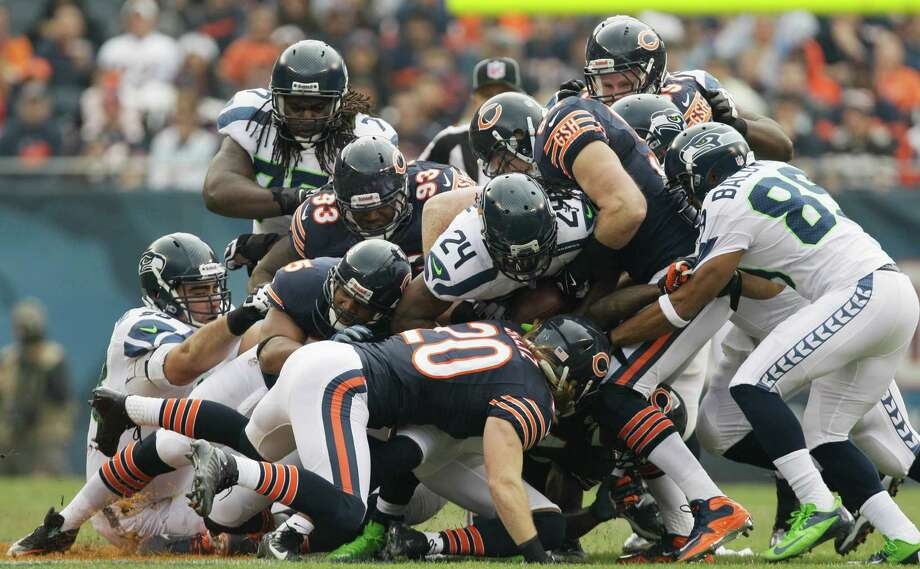 Seattle Seahawks running back Marshawn Lynch (24) is gang-tackled by Chicago Bears defenders in the first half of an NFL football game in Chicago, Sunday, Dec. 2, 2012. Photo: AP