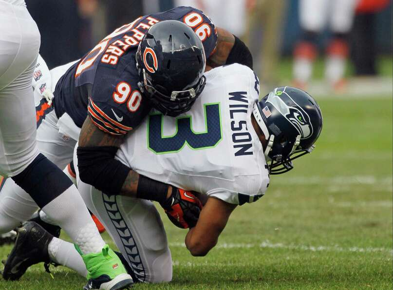 Seattle Seahawks quarterback Russell Wilson (3) is sacked by Chicago Bears defensive end Julius Pepp