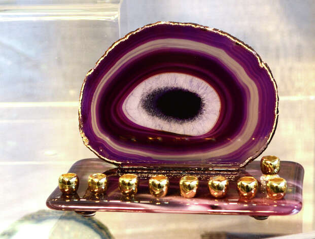 An agate slice menorah designed by Susan Lowenthal, of By Susan Designs, on display at the SoNo Market Place, an indoor European style market located at 314 Wilson Avenue in Norwalk on Saturday, Dec. 1, 2012. Lowenthal is a mixed media artist who incorporates petrified wood, agate, and stones into her work. Photo: Amy Mortensen / Connecticut Post Freelance