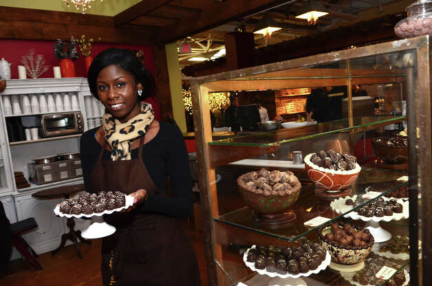 Jazmin Powell, of Chocopologie in Norwalk, holds up a tray of pear truffles, at the SoNo Market Place, an indoor European style market located at 314 Wilson Avenue in Norwalk on Saturday, Dec. 1, 2012. Photo: Amy Mortensen / Connecticut Post Freelance