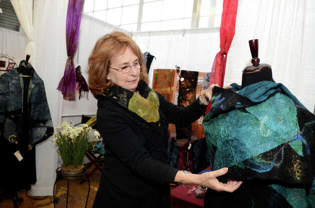 Martha Simpson places a nuno felting shawl on a dress form at the SoNo Market Place, an indoor European style market located at 314 Wilson Avenue in Norwalk on Saturday, Dec. 1, 2012. Photo: Amy Mortensen / Connecticut Post Freelance
