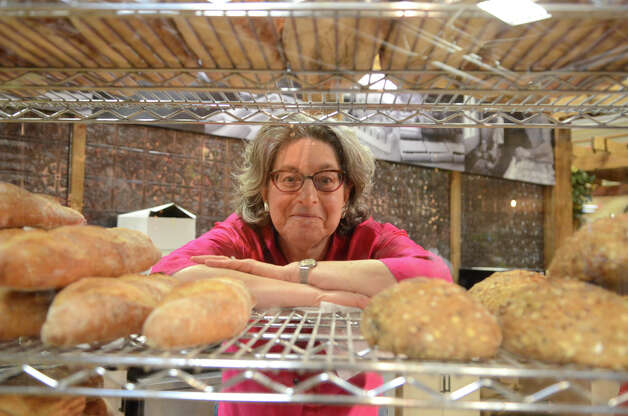 Margaret Sapir, co-owner of Wave Hill Breads located on High Street in Norwalk, poses for a photo behind the bread rack at the SoNo Market Place, an indoor European style market located at 314 Wilson Avenue in Norwalk on Saturday, Dec. 1, 2012. Photo: Amy Mortensen / Connecticut Post Freelance