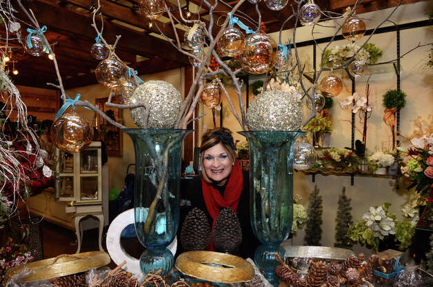 Danna DiElsi, floral designer and owner of the Silk Touch of Norwalk, poses for a photo at her booth at the SoNo Market Place, an indoor European style market located at 314 Wilson Avenue in Norwalk on Saturday, Dec. 1, 2012. Photo: Amy Mortensen / Connecticut Post Freelance