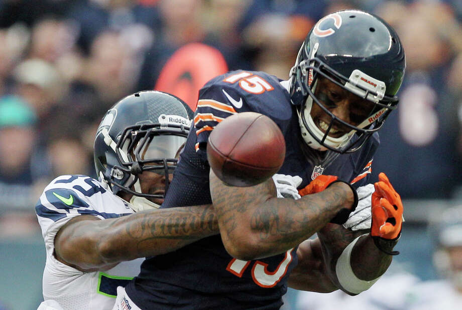Chicago Bears wide receiver Brandon Marshall (15) fumbles after getting hit by Seattle Seahawks cornerback Brandon Browner (39) in the first half of an NFL football game in Chicago, Sunday, Dec. 2, 2012. Marshall recovered his own fumble. Photo: AP