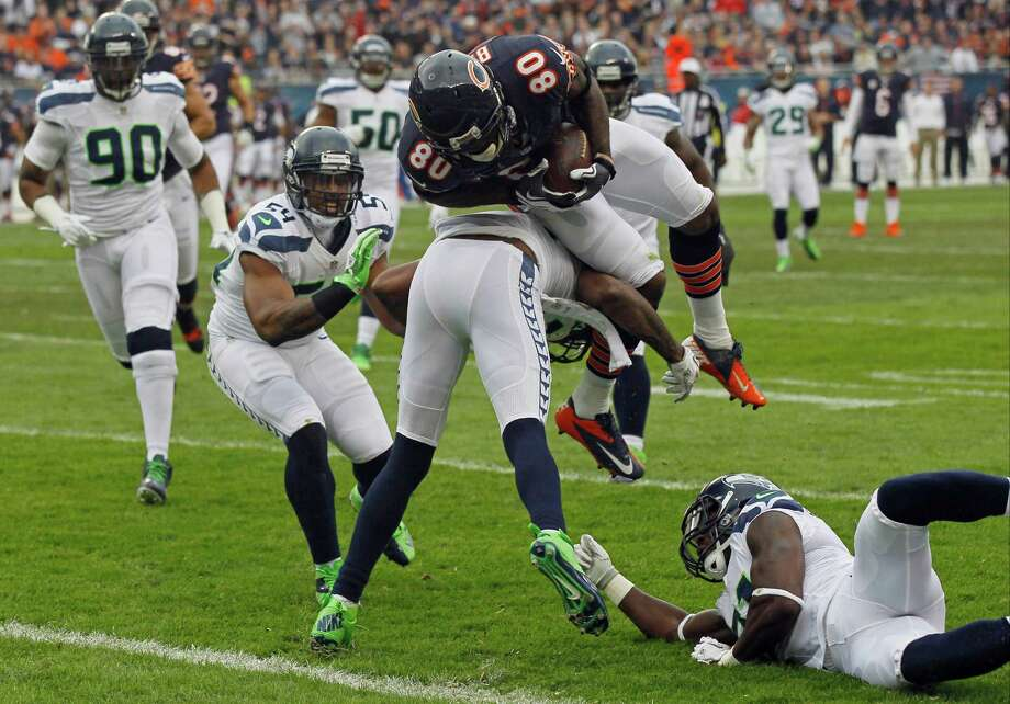 Chicago Bears wide receiver Earl Bennett (80) dives for a touchdown after a 12-yard pass reception against the Seattle Seahawks in the first half of an NFL football game in Chicago, Sunday, Dec. 2, 2012. The play was ruled a touchdown after a review. Photo: AP