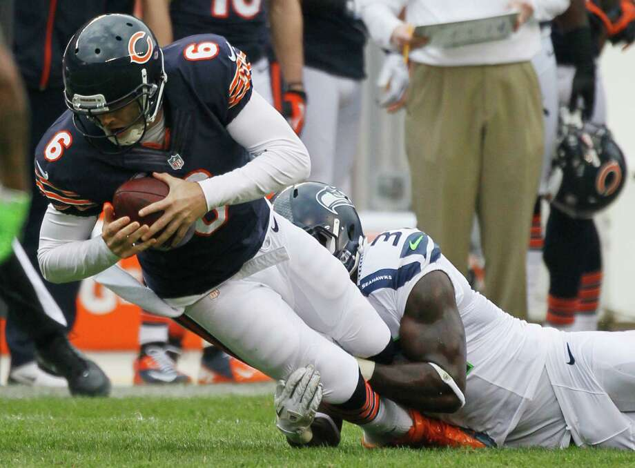 Chicago Bears quarterback Jay Cutler (6) is tackled after picking up a first down by Seattle Seahawks safety Kam Chancellor (31) in the first half of an NFL football game in Chicago, Sunday, Dec. 2, 2012. Photo: AP