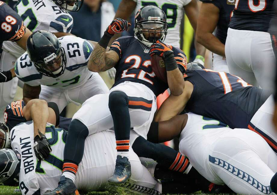 Chicago Bears running back Matt Forte (22) fights for extra yardage against the Seattle Seahawks in the first half of an NFL football game in Chicago, Sunday, Dec. 2, 2012. Photo: AP