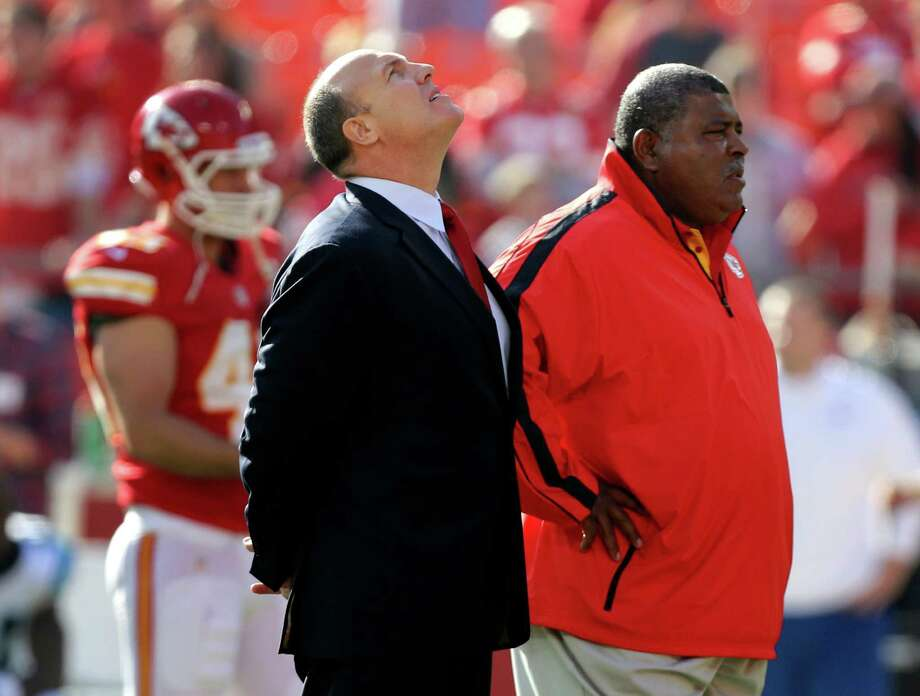 Kansas City Chiefs general manager Scott Pioli, left, and coach Romeo Crennel stand together before an NFL football game against the Carolina Panthers at Arrowhead Stadium in Kansas City, Mo., Sunday, Dec. 2, 2012. (AP Photo/Ed Zurga) Photo: Ed Zurga, FRE / FR34145 AP