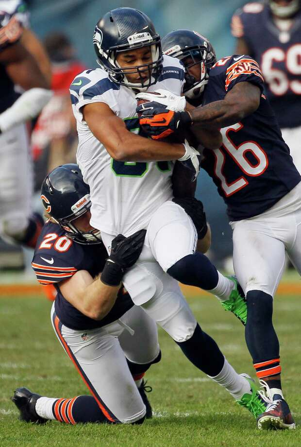 Seattle Seahawks wide receiver Golden Tate (81) is tackled by Chicago Bears safety Craig Steltz (20) and cornerback Tim Jennings (26) in the first half of an NFL football game in Chicago, Sunday, Dec. 2, 2012. Photo: AP
