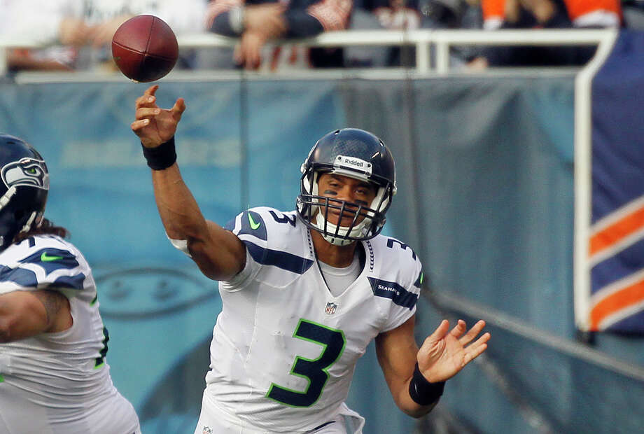 Seattle Seahawks quarterback Russell Wilson (3) throws a pass against the Chicago Bears in the first half of an NFL football game in Chicago, Sunday, Dec. 2, 2012. Photo: AP