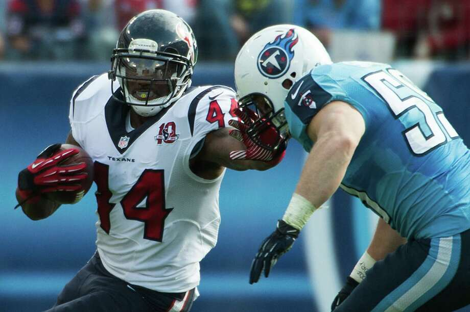 Houston Texans running back Ben Tate (44) fends of a Tennessee Titans tackler during the first half of an NFL football game at LP Field on Sunday, Dec. 2, 2012, in Nashville. Photo: Smiley N. Pool, Houston Chronicle / © 2012  Houston Chronicle