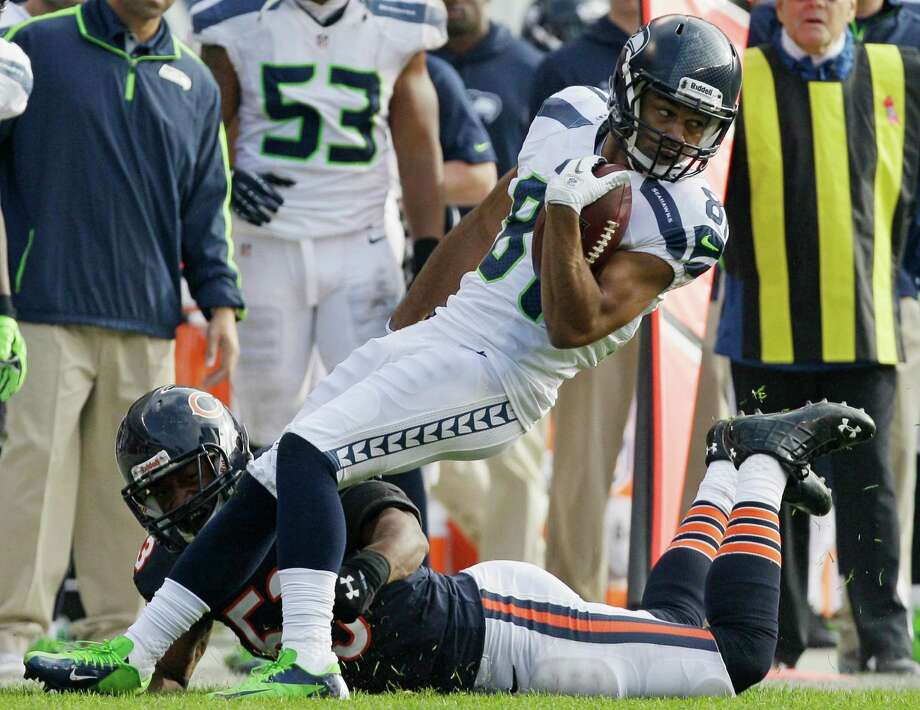 Seattle Seahawks wide receiver Golden Tate (81) is tackled by Chicago Bears linebacker Nick Roach in the first half of an NFL football game in Chicago, Sunday, Dec. 2, 2012. Photo: AP
