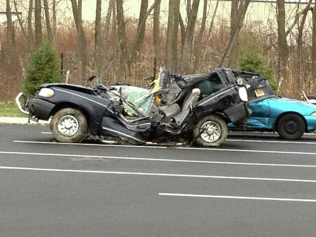 Remains of the 2004 Ford Explorer driven by Shenendehowa senior Chris Stewart after his vehicle was hit Saturday night on the Northway. Stewart and Shenendehowa senior Deanna Rivers were killed and two other students were injured. (Bryan Fitzgerald / Times Union)