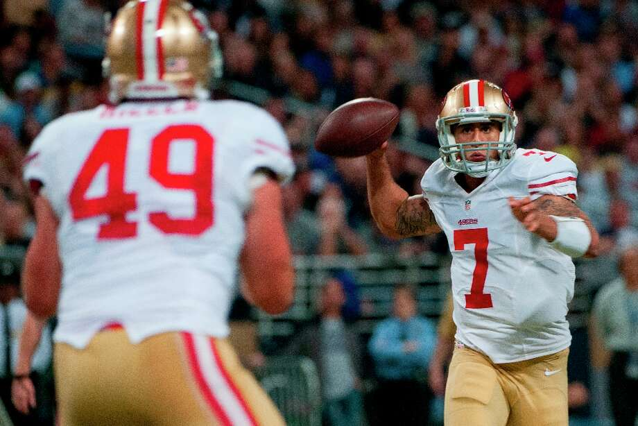 Colin Kaepernick (7) of the 49ers sends a pass to Bruce Miller (49) of the 49ers  during the NFL game between the San Francisco 49ers vs the St. Louis Rams at the Edward Jones Dome in St. Louis Missouri.  (Danny Reise / SPECIAL TO THE CHRONICLE) Photo: Danny Reise, SFC / Danny Reise