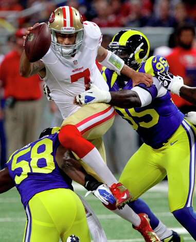 San Francisco 49ers quarterback Colin Kaepernick is sacked for a 7-yard loss by St. Louis Rams outside linebacker Jo-Lonn Dunbar (58) and defensive end William Hayes, right, during the first quarter of an NFL football game Sunday, Dec. 2, 2012, in St. Louis. Photo: Seth Perlman, Associated Press / AP