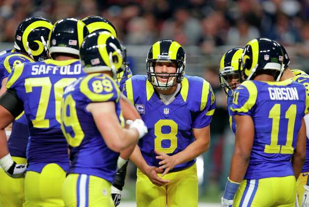 St. Louis Rams quarterback Sam Bradford (8) talks to teammates in the huddle during the second quarter of an NFL football game against the San Francisco 49ers Sunday, Dec. 2, 2012, in St. Louis. Photo: Tom Gannam, Associated Press / FR45452 AP