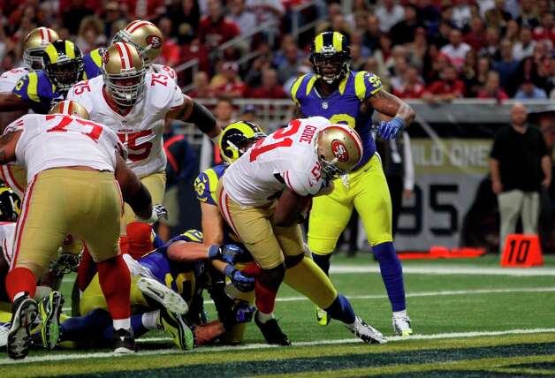 San Francisco 49ers running back Frank Gore (21) scores on a 1-yard run during the first quarter of an NFL football game against the St. Louis Rams Sunday, Dec. 2, 2012, in St. Louis. Photo: Seth Perlman, Associated Press / AP
