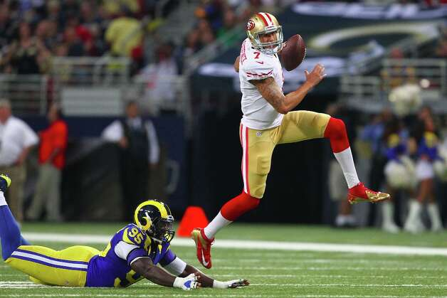 ST. LOUIS, MO - DECEMBER 2: Colin Kaepernick #7 of the San Francisco 49ers avoids getting tackled by William Hayes #95 of the St. Louis Rams at the Edward Jones Dome on December 2, 2012 in St. Louis, Missouri. Photo: Dilip Vishwanat, Getty Images / 2012 Getty Images