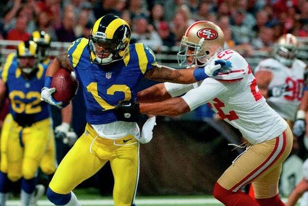 Chris Givens (13) of the St. Louis Rams breaks free from a tackle by Carlos Rogers (22) of the 49ers during the NFL game between the San Francisco 49ers vs the St. Louis Rams at the Edward Jones Dome in St. Louis Missouri.  (Danny Reise / SPECIAL TO THE CHRONICLE) Photo: Danny Reise, SFC / Danny Reise