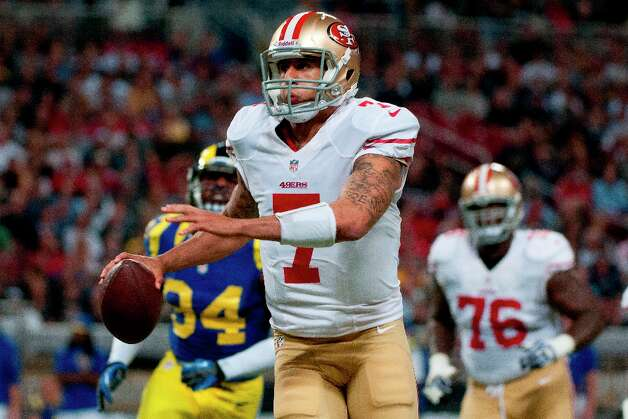 Colin Kaepernick (7) of the 49ers under pressure runs to to the side line during the NFL game between the San Francisco 49ers vs the St. Louis Rams at the Edward Jones Dome in St. Louis Missouri.  (Danny Reise / SPECIAL TO THE CHRONICLE) Photo: Danny Reise, SFC / Danny Reise