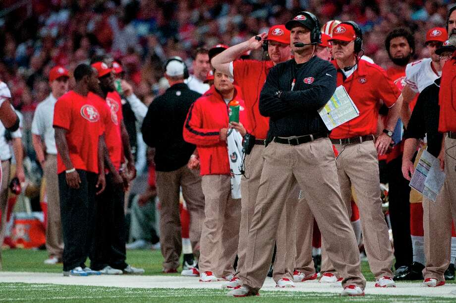 Head coach of the 49ers Jim Harbaugh watching the 49ers kick the first extra point during the NFL game between the San Francisco 49ers vs the St. Louis Rams at the Edward Jones Dome in St. Louis Missouri.  (Danny Reise / SPECIAL TO THE CHRONICLE) Photo: Danny Reise, SFC / Danny Reise