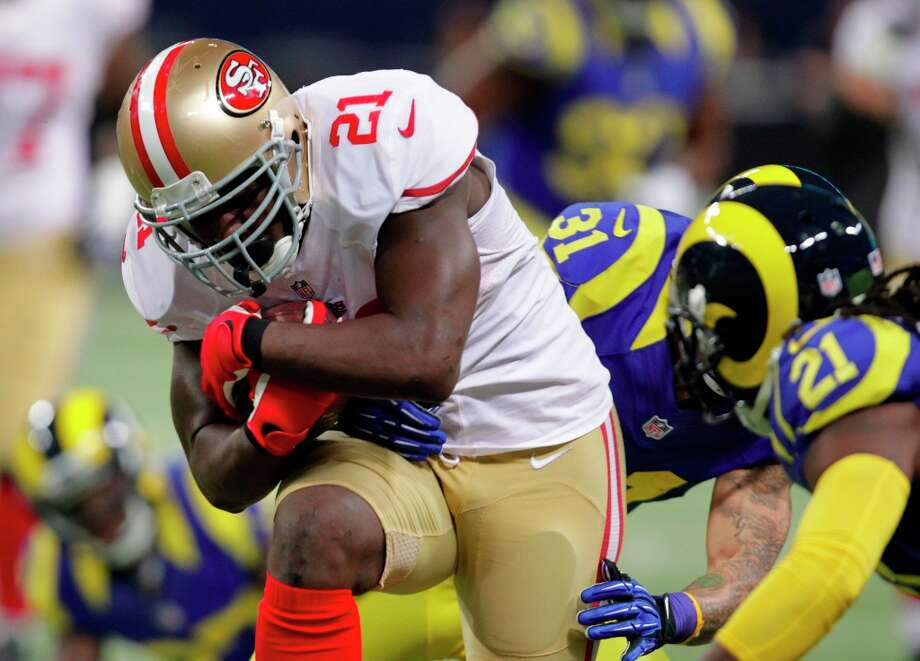 San Francisco 49ers running back Frank Gore runs for a 23-yard gain during the first quarter of an NFL football game against the St. Louis Rams Sunday, Dec. 2, 2012, in St. Louis. Photo: Tom Gannam, Associated Press / FR45452 AP