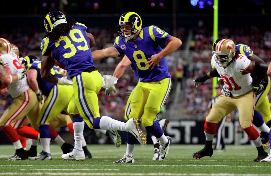 St. Louis Rams quarterback Sam Bradford (8) hands off to running back Steven Jackson during the first quarter of an NFL football game against the San Francisco 49ers Sunday, Dec. 2, 2012, in St. Louis. Photo: Tom Gannam, Associated Press / FR45452 AP