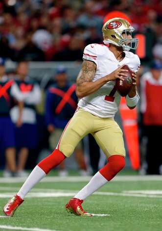 San Francisco 49ers quarterback Colin Kaepernick drops back to pass during the first quarter of an NFL football game against the St. Louis Rams Sunday, Dec. 2, 2012, in St. Louis. Photo: Jeff Roberson, Associated Press / AP