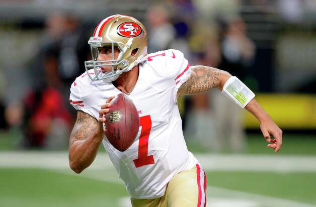 San Francisco 49ers quarterback Colin Kaepernick scrambles during the first quarter of an NFL football game against the St. Louis Rams Sunday, Dec. 2, 2012, in St. Louis. Photo: Tom Gannam, Associated Press / FR45452 AP