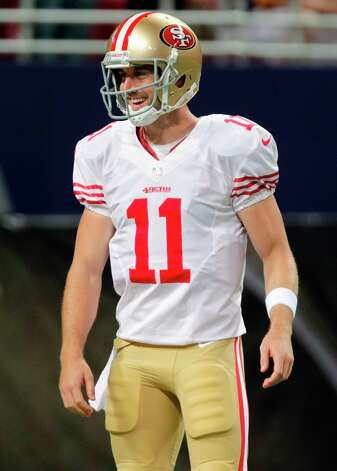 San Francisco 49ers quarterback Alex Smith smiles as he warms up before the start of an NFL football game between the St. Louis Rams and the San Francisco 49ers Sunday, Dec. 2, 2012, in St. Louis. Photo: Tom Gannam, Associated Press / FR45452 AP