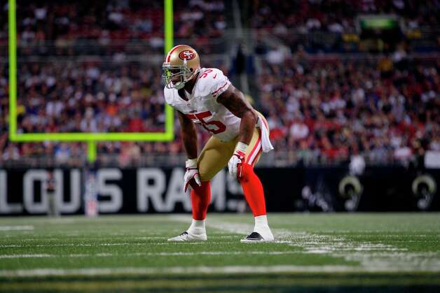 San Francisco 49ers outside linebacker Ahmad Brooks takes up his position during the first quarter of an NFL football game against the St. Louis Rams Sunday, Dec. 2, 2012, in St. Louis. Photo: Tom Gannam, Associated Press / FR45452 AP