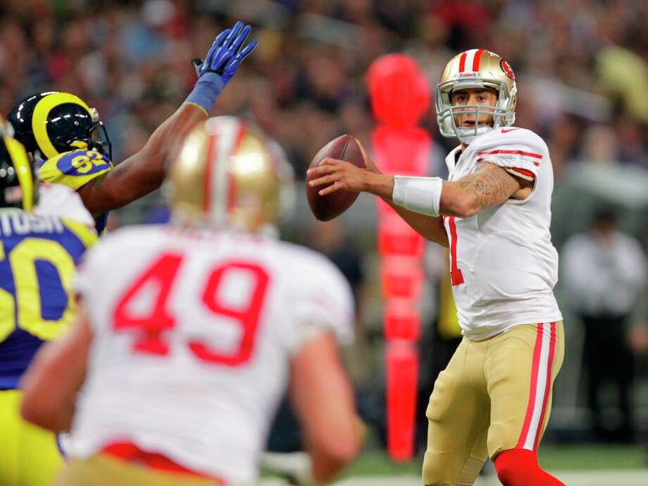 San Francisco 49ers quarterback Colin Kaepernick throws during the first quarter of an NFL football game against the St. Louis Rams Sunday, Dec. 2, 2012, in St. Louis. Photo: Tom Gannam, Associated Press / FR45452 AP