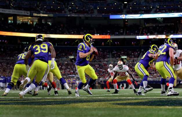 St. Louis Rams quarterback Sam Bradford drops back to pass during the first quarter of an NFL football game against the San Francisco 49ers Sunday, Dec. 2, 2012, in St. Louis. Photo: Tom Gannam, Associated Press / FR45452 AP