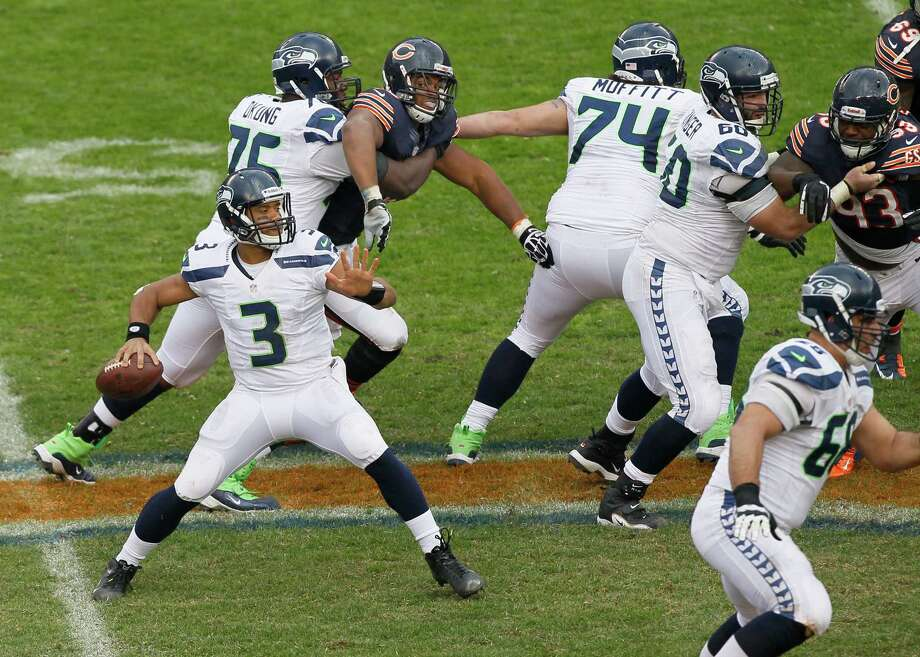 Seattle Seahawks quarterback Russell Wilson (3) throws a pass against the Chicago Bears in the second half of an NFL football game in Chicago, Sunday, Dec. 2, 2012. Photo: AP